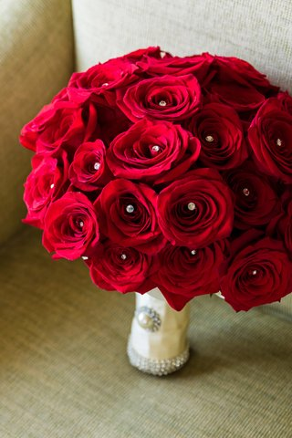bridal-bouquet-of-red-roses-with-crystals-in-the-middle