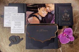 wedding-invitation-with-photo-of-bride-and-groom-engagement-image-gold-foil-black-passport-orchid