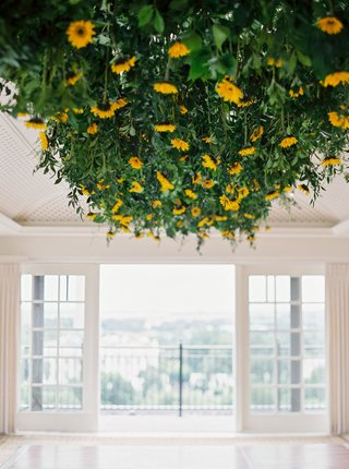 wedding-reception-in-washington-dc-sunflowers-and-greenery-leaves-overhead-above-dance-floor