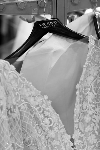 black-and-white-up-close-shot-of-yaki-ravid-couture-wedding-dress-on-hanger