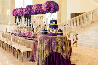 wedding-cake-table-with-purple-linens-an-sheer-linen-with-gold-appliques-on-top