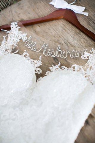 wedding-dress-hanger-with-custom-name-cursive-white-bow-wood-hanger