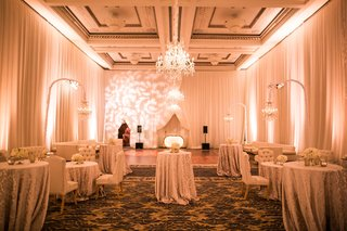wedding-reception-after-party-linens-on-cocktail-tables-dining-chairs-dance-floor-chandelier