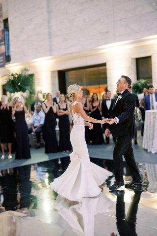 wedding-reception-first-dance-mirror-dance-floor-bride-in-pronovias-gown-bustle-for-dancing-updo