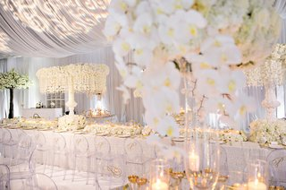 wedding-reception-white-long-table-clear-chairs-monogram-orchids-drapery-projection-lighting-design