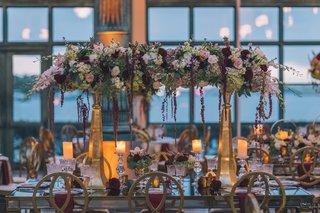 henry-morrison-flagler-museum-wedding-gold-pillars-with-flowers-across-burgundy-white-ivory-blush