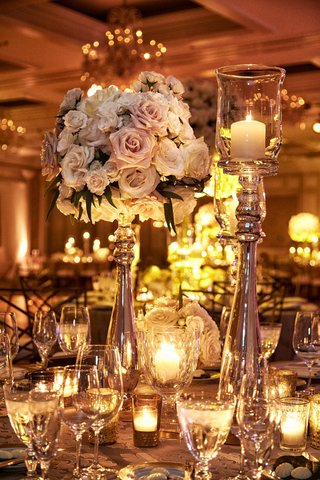 tall-centerpiece-arrangement-with-pink-rose-ivory-rose-candlelight-in-tall-candleholders