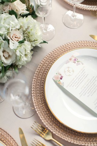ornate-rose-gold-charger-plates-paired-with-white-china-trimmed-with-gold