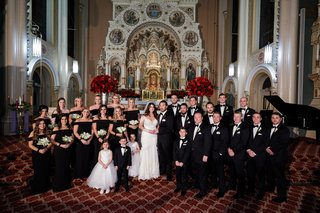 wedding-party-at-chicago-catholic-church-red-roses-black-off-shoulder-bridesmaid-dresses-groomsmen