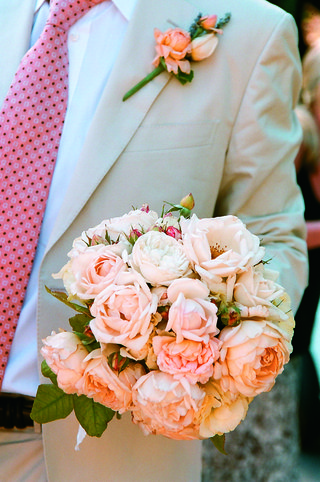 groom-holds-white-and-pink-peony-wedding-bouquet