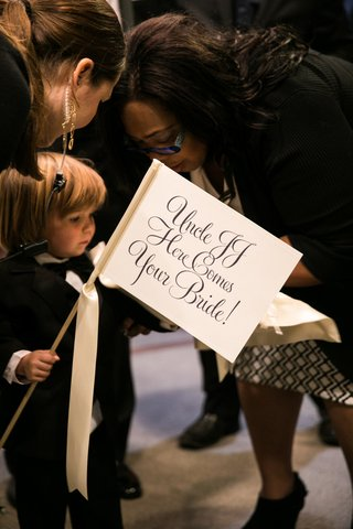 ring-bearer-with-here-comes-the-bride-sign-for-his-uncles-wedding