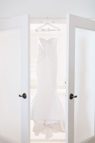 wedding-dress-fluted-bridal-gown-oscar-de-la-renta-wedding-hanger-french-doors-bridal-suite