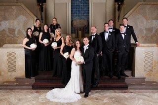 bride-in-monique-lhuillier-wedding-dress-with-groom-in-tuxedo-white-bow-tie-and-wedding-party-black