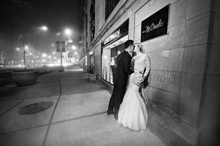 rob-refsnyder-of-new-york-yankees-bride-and-groom-kiss-outside-the-drake-hotel-chicago-wedding