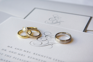platinum-mens-band-and-gold-diamond-rings-on-invite