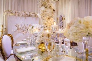 wedding-reception-legacy-castle-tahir-whitehead-white-gold-mirror-decor-s-shape-table