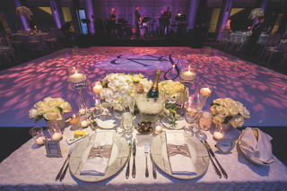 table-with-ivory-flowers-and-view-of-the-dance-floor