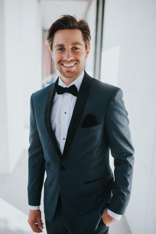 alex-kuznetsov-in-navy-tuxedo-on-wedding-day
