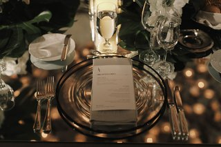 wedding-reception-black-rim-charger-plate-napkin-menu-card-monogram-mirror-table-top-jungle-leaves