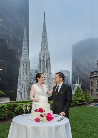 wiping-a-bit-of-cake-off-her-groom-at-620-loft-o-fifth-ave-with-a-view-to-st-patricks-cathedral