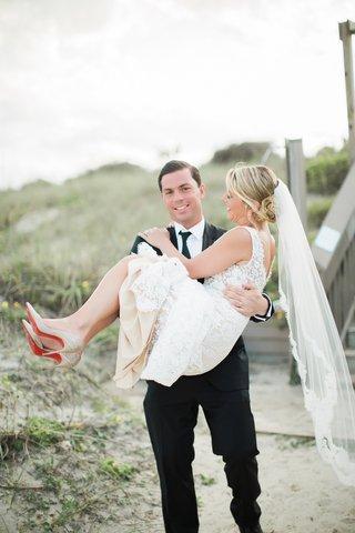 bride-in-alon-livne-lace-dress-carried-by-groom-in-hugo-boss-suit