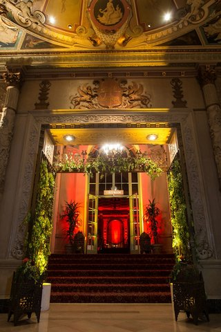 gold-room-entryway-with-floor-lanterns-and-trees