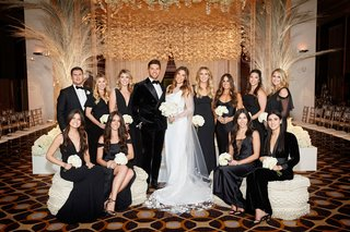 bride-in-vera-wang-wedding-dress-groom-velvet-tuxedo-bridesmaids-in-black-mismatch-dresses-ceremony