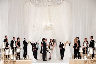 oval-roof-chuppah-wedding-ceremony-chicago-white-drapery-candelabra-black-and-white-attire-wedding