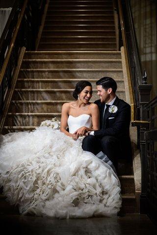wedding-portrait-bride-in-pretty-ines-di-santo-wedding-dress-with-ruffle-texture-skirt-groom-suit