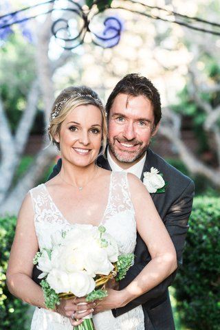 ted-adams-idw-publishing-ceo-in-a-grey-suit-with-bride-in-a-sleeveless-claire-pettibone-dress