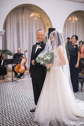 asian-bride-and-father-smiling-at-the-end-of-walking-down-the-aisle-bride-in-blusher-veil