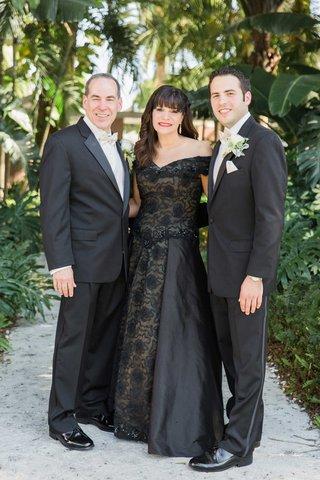 groom-black-suit-parents-wedding-attire-black-dress-off-the-shoulder-florida-wedding-classic