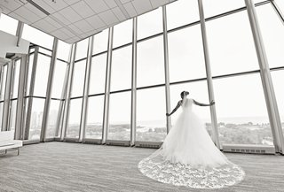 bel-aire-bridal-cathedral-veil-with-lace-details-throughout-black-and-white-photo