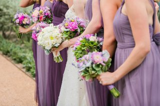 colorful-berry-tone-bridesmaids-bouquets-and-white-flowers-in-brides-bouquet-purple-dresses