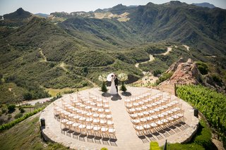 malibu-rocky-oaks-wedding-ceremony-on-helipad-bride-with-parasol