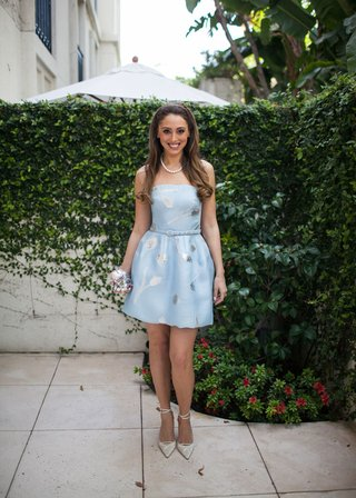 bride-at-bridal-shower-in-light-blue-strapless-cocktail-dress-with-silver-pattern