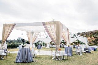 wedding reception ranch tent reception and arbor dance floor drapery chandelier pendant lantern