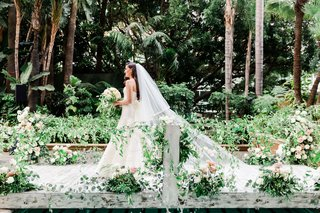 wedding processional on custom built bridge at four seasons los angeles at beverly hills greenery