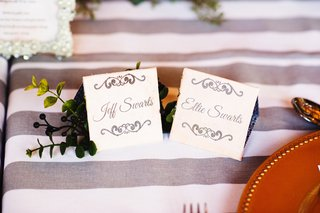 white-place-cards-with-gray-type-and-scrolls