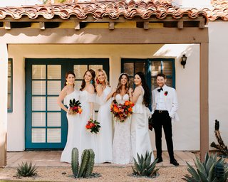 wedding party unique alternative bride with bridesmaids in white dresses and bridesman white suit tuxedo