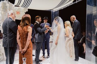 bride and groom with parents under lucite chuppah tallit jewish wedding in australia
