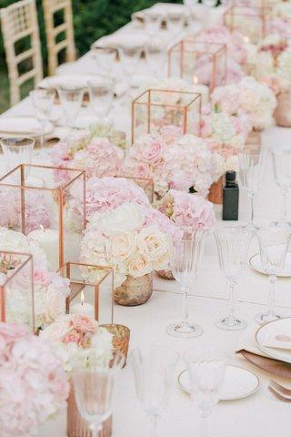 wedding-reception-long-centerpiece-mini-rose-arrangements-candle-votives-rose-gold-vessels-geometric