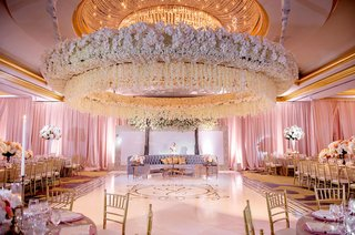 wedding-reception-orchid-flower-arrangement-ceiling-lounge-area-gold-monogram-dance-floor