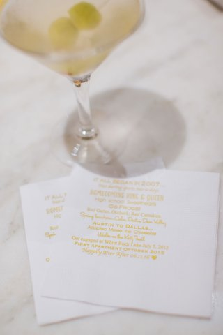 martini-on-cocktail-napkin-with-memorable-moments-during-their-courtship-romance