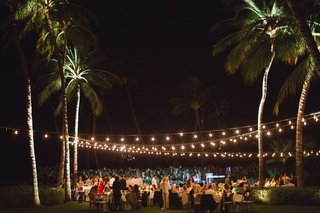 destination-wedding-in-maui-outdoor-reception-at-night-with-bistro-lights-and-palm-trees