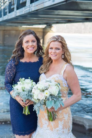 bride-in-gold-wedding-dress-with-bridesmaid-in-lace-blue-dress
