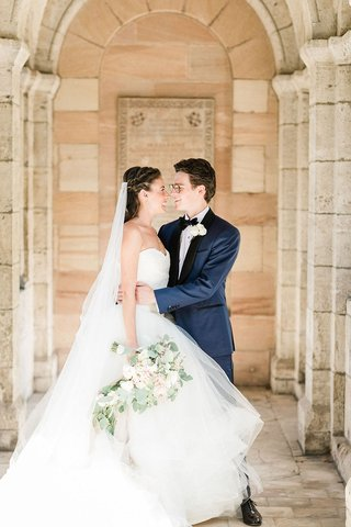 wedding-portrait-bride-in-vera-wang-wedding-dress-veil-groom-in-navy-black-tuxedo-jacket-glasses