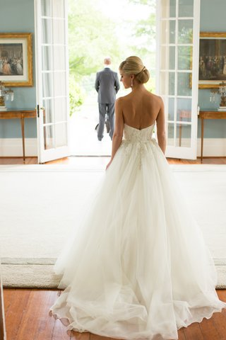back-of-bride-wearing-strapless-bridal-gown