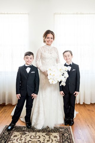 bride-in-high-neck-long-sleeve-wedding-dress-orchid-bouquet-ring-bearers-in-tuxes