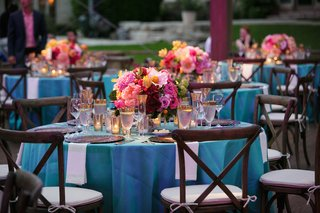 wedding-reception-with-wood-chairs-around-table-with-turquoise-tablecloth